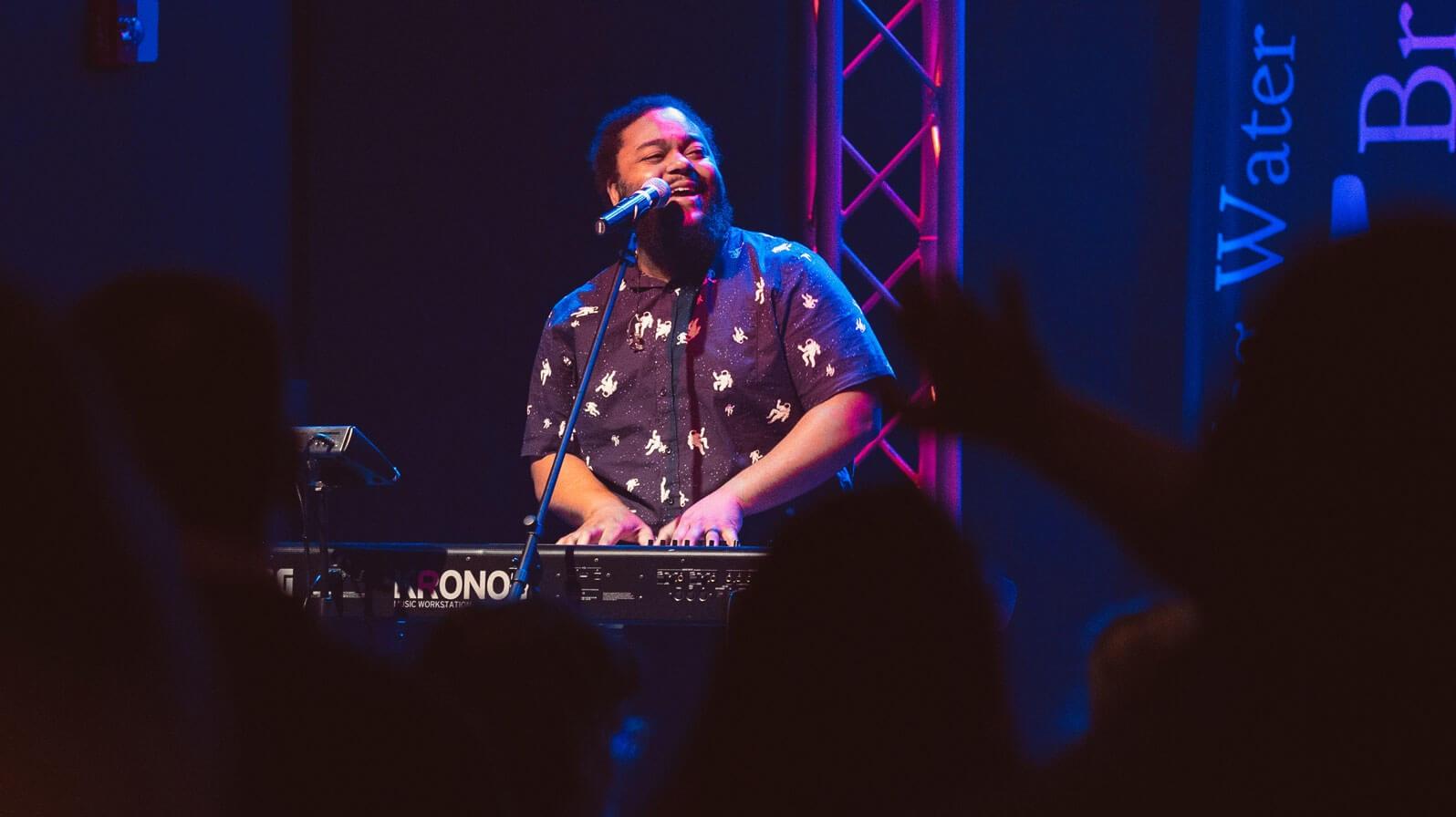 Moses playing keyboard and singing