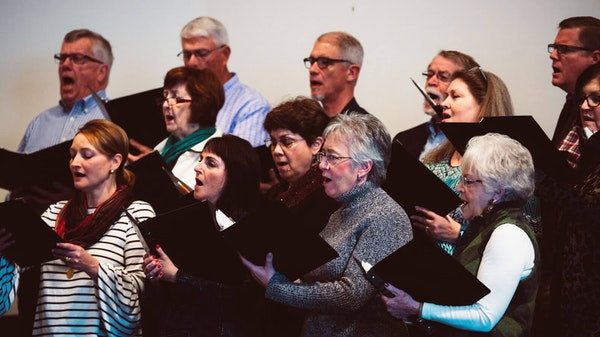 Adults singing in at a choir practice at Saxe Gotha
